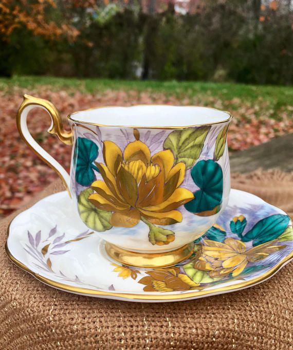 Royal Albert Bone China teacups from England are the holy grail. The Crème de la Crème of tea time loveliness. The vivid colors, fine detailing and fancy gold trim on this cup and saucer set are no exception to the English standard of excellence. It's GORGEOUS and in wonderful
