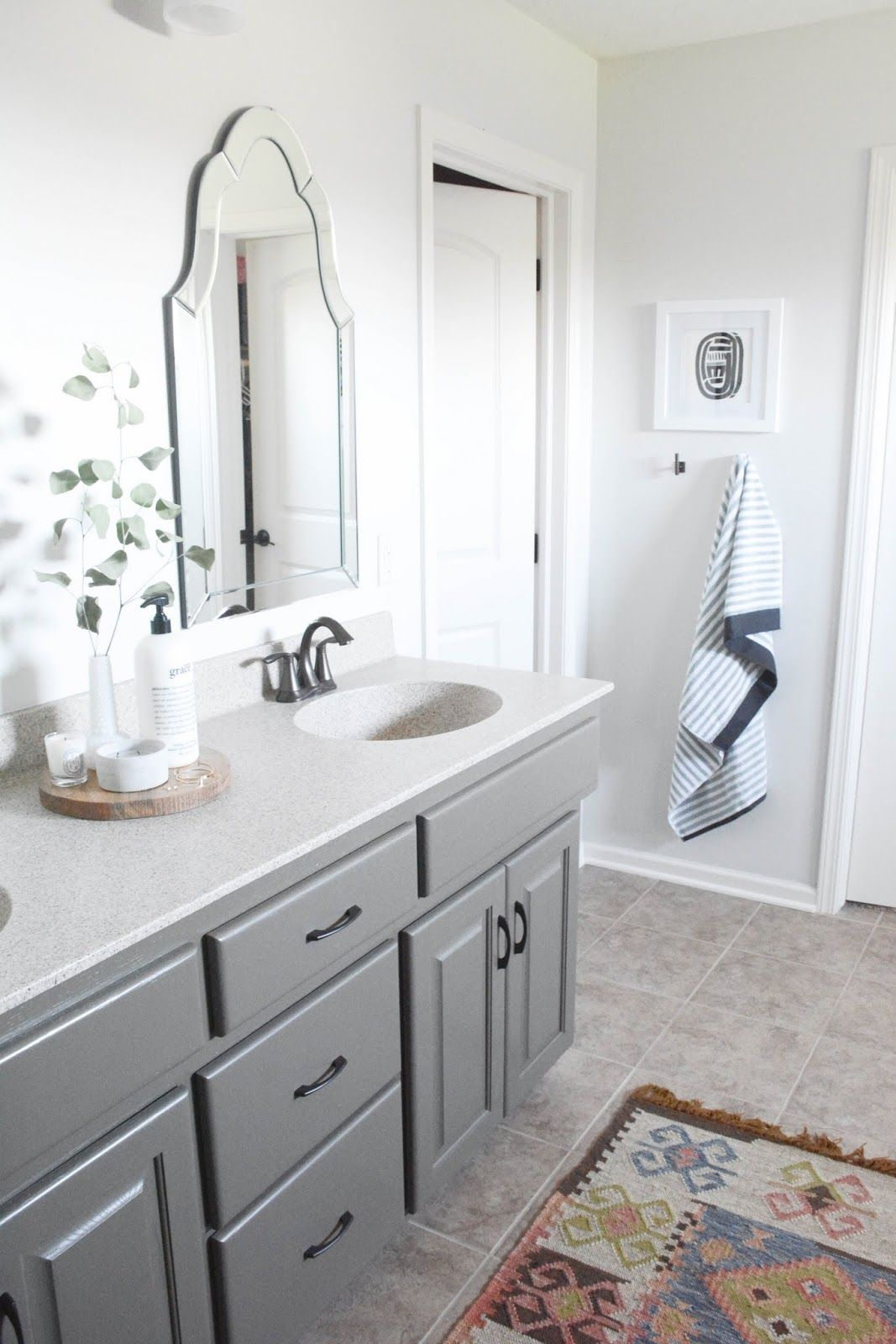 Master Bathroom // oak cabinets painted Sherwin Williams Porpoise, walls are Behr Silver Drop, kilim rug, Hickory Hardware Greenwich pulls