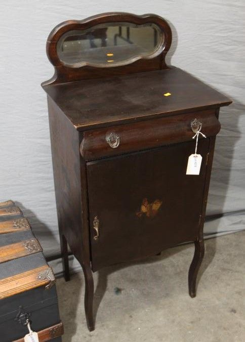 """Music cabinet with mirrored back, single drawer over single door, inlayed decoration. 19.5""""x14""""x45.5""""T. Pickup only.Antique & Estate Auction ending 5/19/13"""