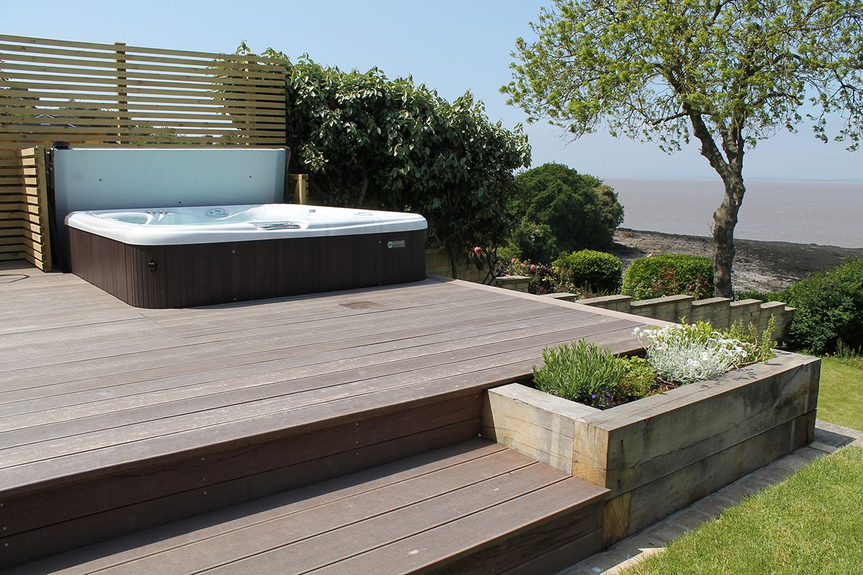 Waterfront Back Garden | outerspace | Hot tub patio ... on Waterfront Backyard Ideas id=79341