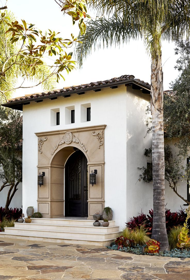 Classic exterior grand entrance arch doorway white exterior stone driveway large front ent
