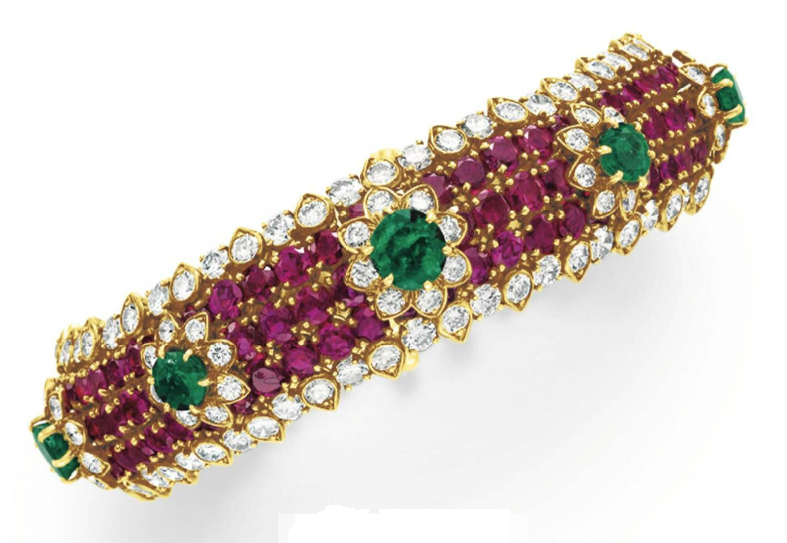 A DIAMOND, RUBY AND EMERALD BRACELET, BY DAVID WEBB  Designed as a circular-cut ruby band, set with a series of circular-cut emerald and diamond flower blossoms, to the circular-cut diamond trim, mounted in 18k gold, circa 1969