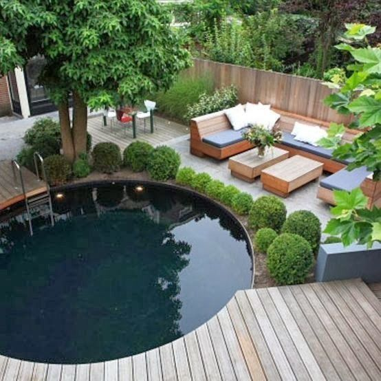 Am nagement jardin avec piscine ronde terrasse for Amenagement jardin 77