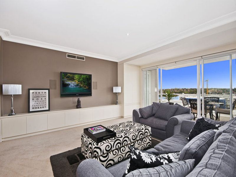 Open Plan Living Room Using White Colours With Carpet Floor To Ceiling Windows