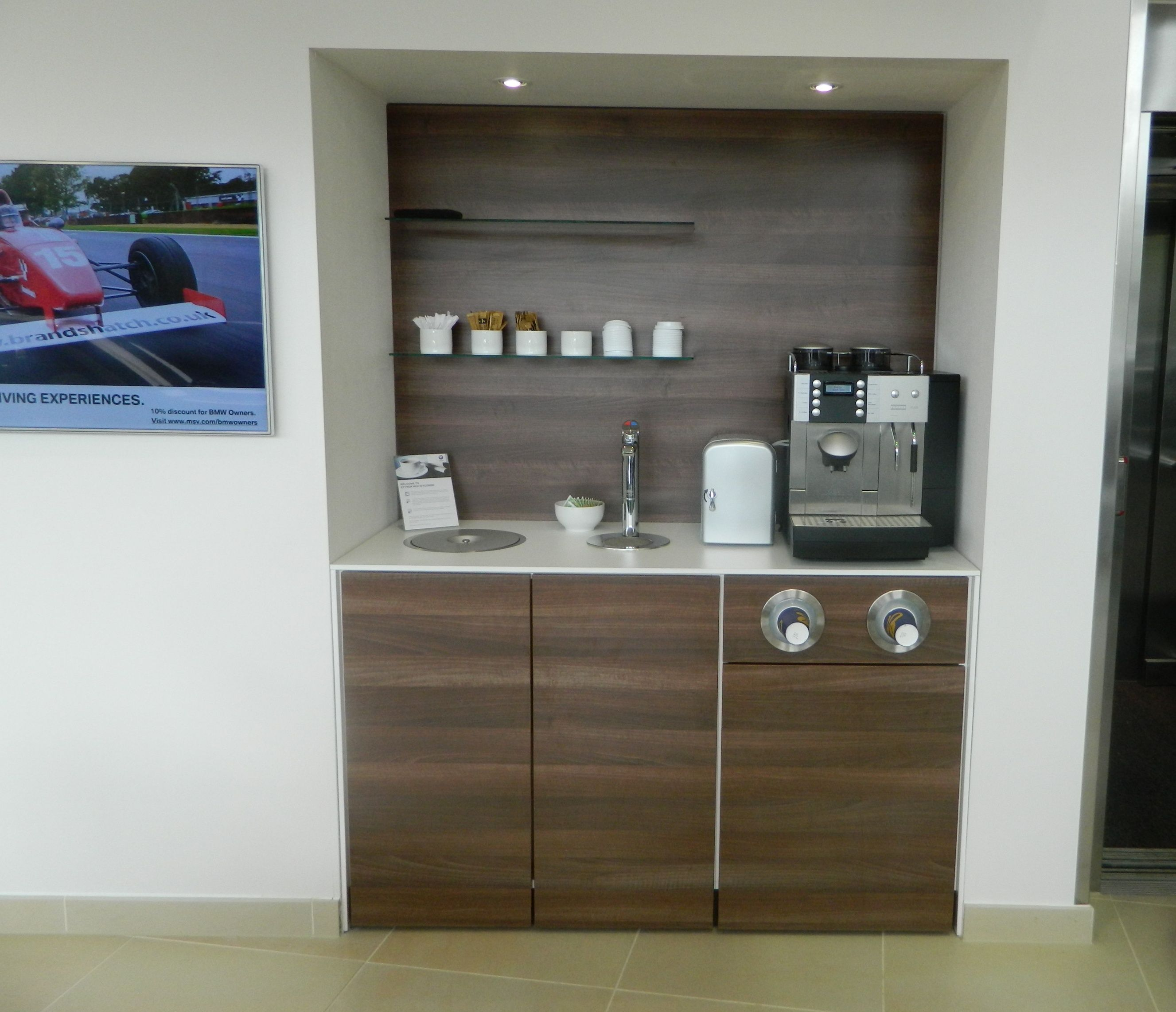 Walnut units with contrasting white worktop Built in recycle point