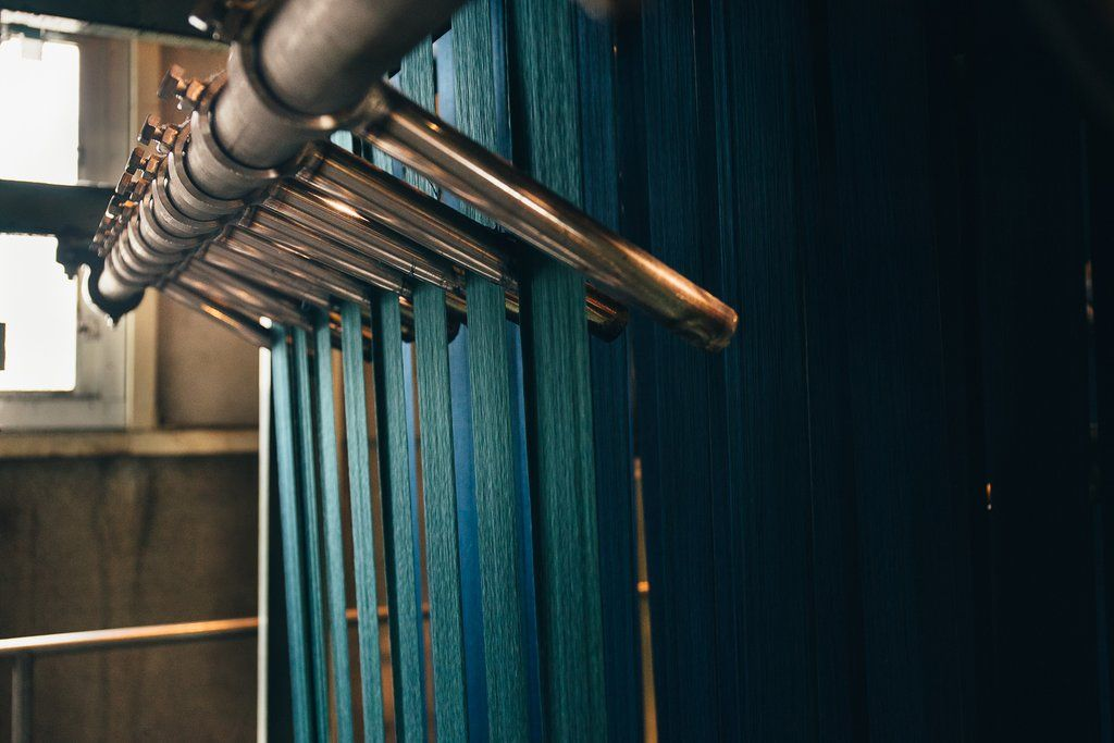 Tingindo fio de jeans em uma máquina Rope Dye