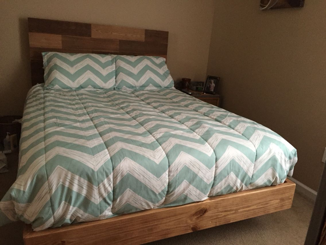 "Queen size bed frame. Made from pine with a ""hidden leg"