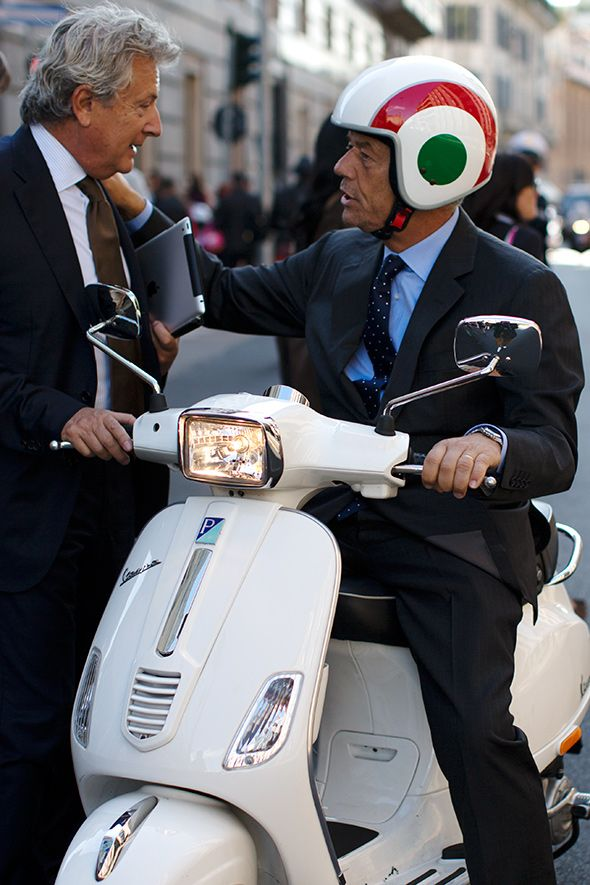 There are so many things to like here. Older business men dressed to the 9s, but one on a scooter, with a rad helmet, chatting with a friend, hand on shoulder. Nothing you'd ever see in the States. Plus, look at that nice grey head of hair! Sartorialist