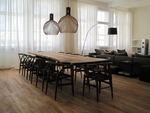 Hans Wegner black wishbone chairs around a large table, large