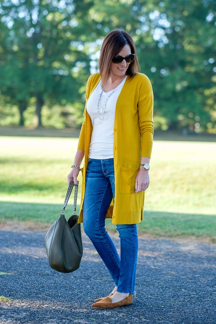 94f8f68a64 Jo-Lynne Shane wearing a mustard cardigan outfit with moss green bag and  cognac loafers.