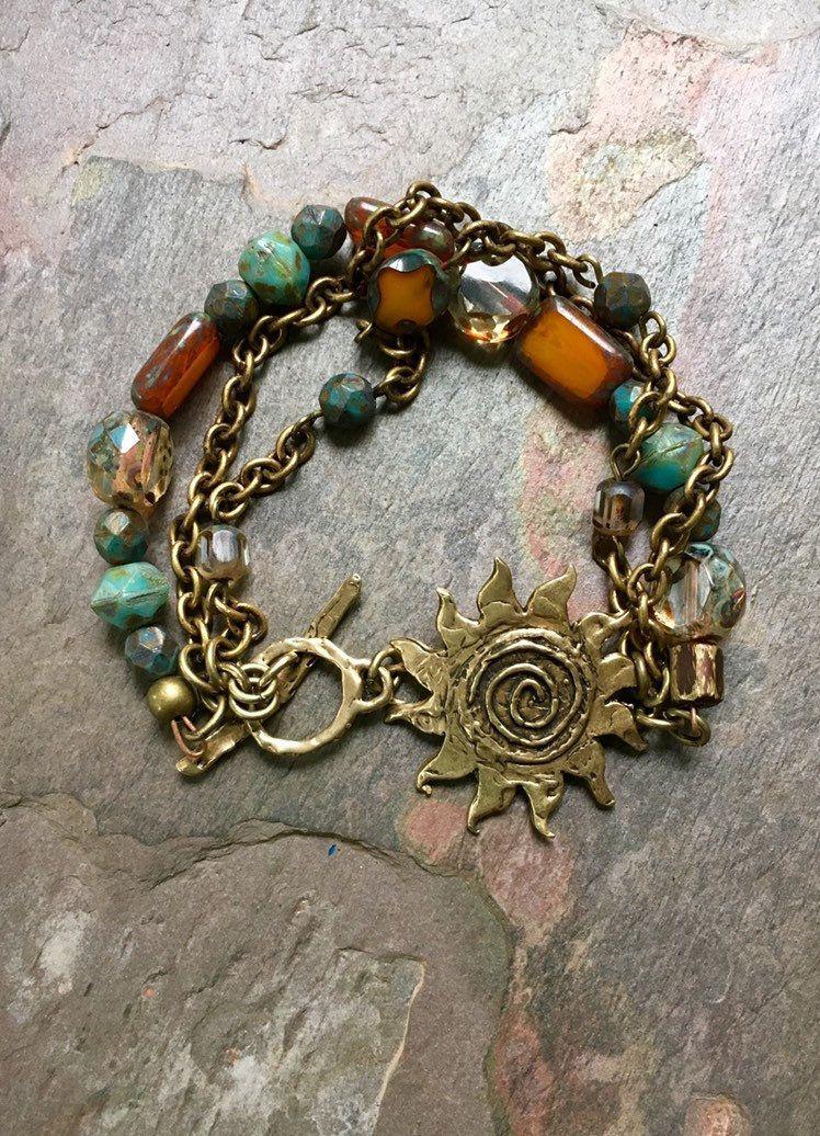 Pretty triple strand bracelet of mottled Czech glass and copper chain