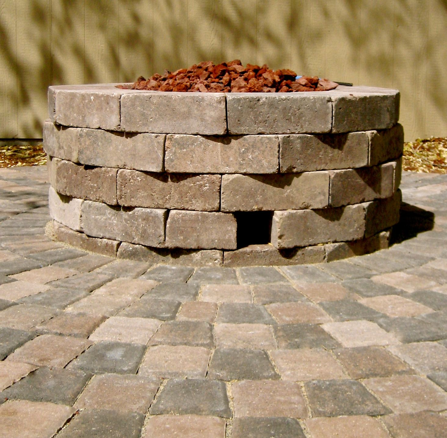 Circular Paver Patio Made With Square Stones Surrounding An Off Set Rectangular Brick Custom Designed Gas Fire Pit Landscaping Gazebo With Fire Pit Fire Pit
