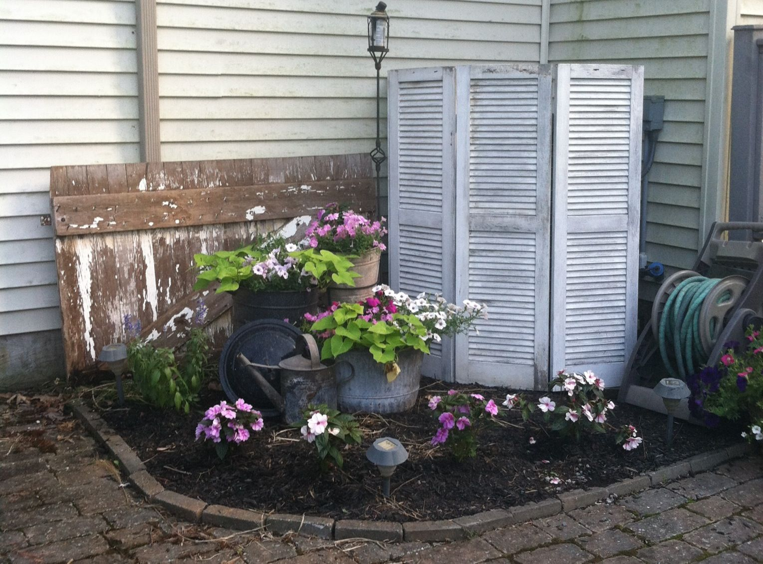 Old shutters to hide air conditioning unit Backyard