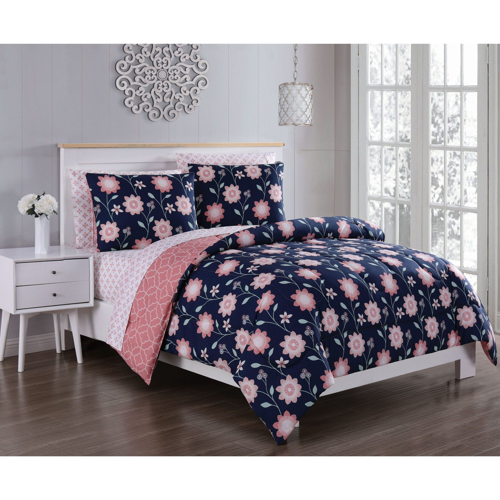 navy blue and white bed in a bag queen