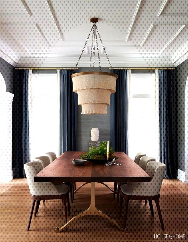 Silvery blue grasscloth wallpaper and ombré drapery make the dining room cozy. | Photographer Al