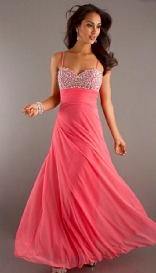 A Flowing Peach Dress With Beading On The Top Formal Dresses