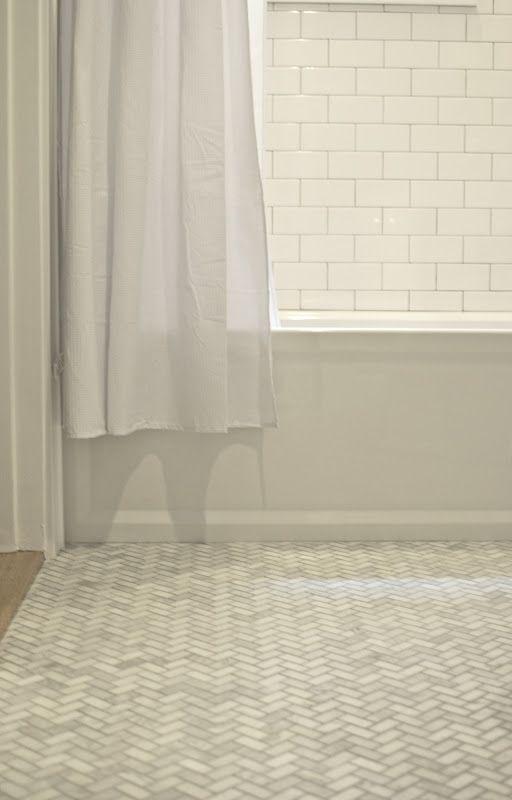 White Subway Tile Walls And Marble Herringbone Floors Herringbone Floor White Subway Tile Upstairs Bathrooms