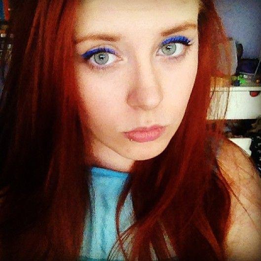 blue eyeliner, red hair