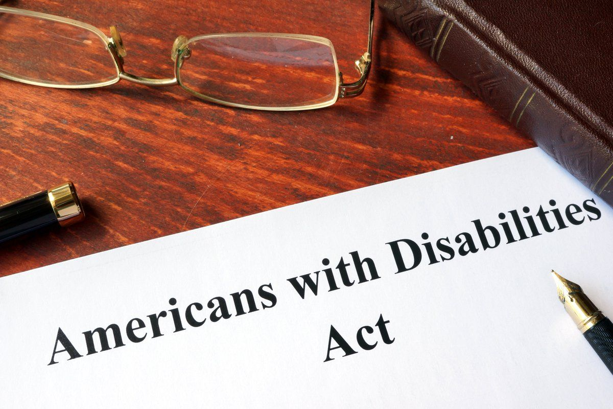 """A piece of paper with """"Americans with Disabilities Act"""