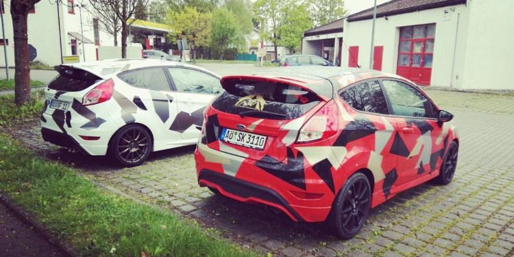 Two Camouflaged Ford Fiesta STs'