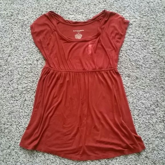 MATERNITY Liz Lange top Super comfy maternity top! Darker than photos, more of a rusty orange. One of my favorite tops to wear while preggo, so there is pilling in areas. Looks great with jeans or white shorts! Great for post baby, too.  Would be a great bundle item :) Liz Lange Tops