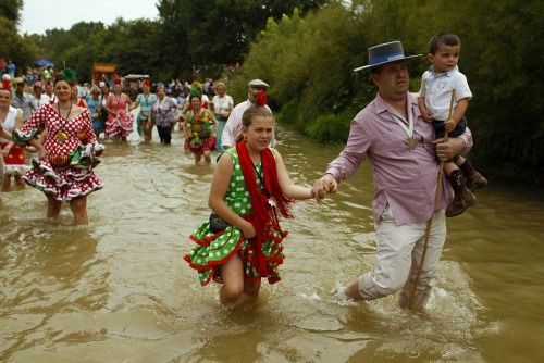 Crossing the river at El Rocio Pilgrimage in Andalusia. A genuine pilgrimage, don't miss it!