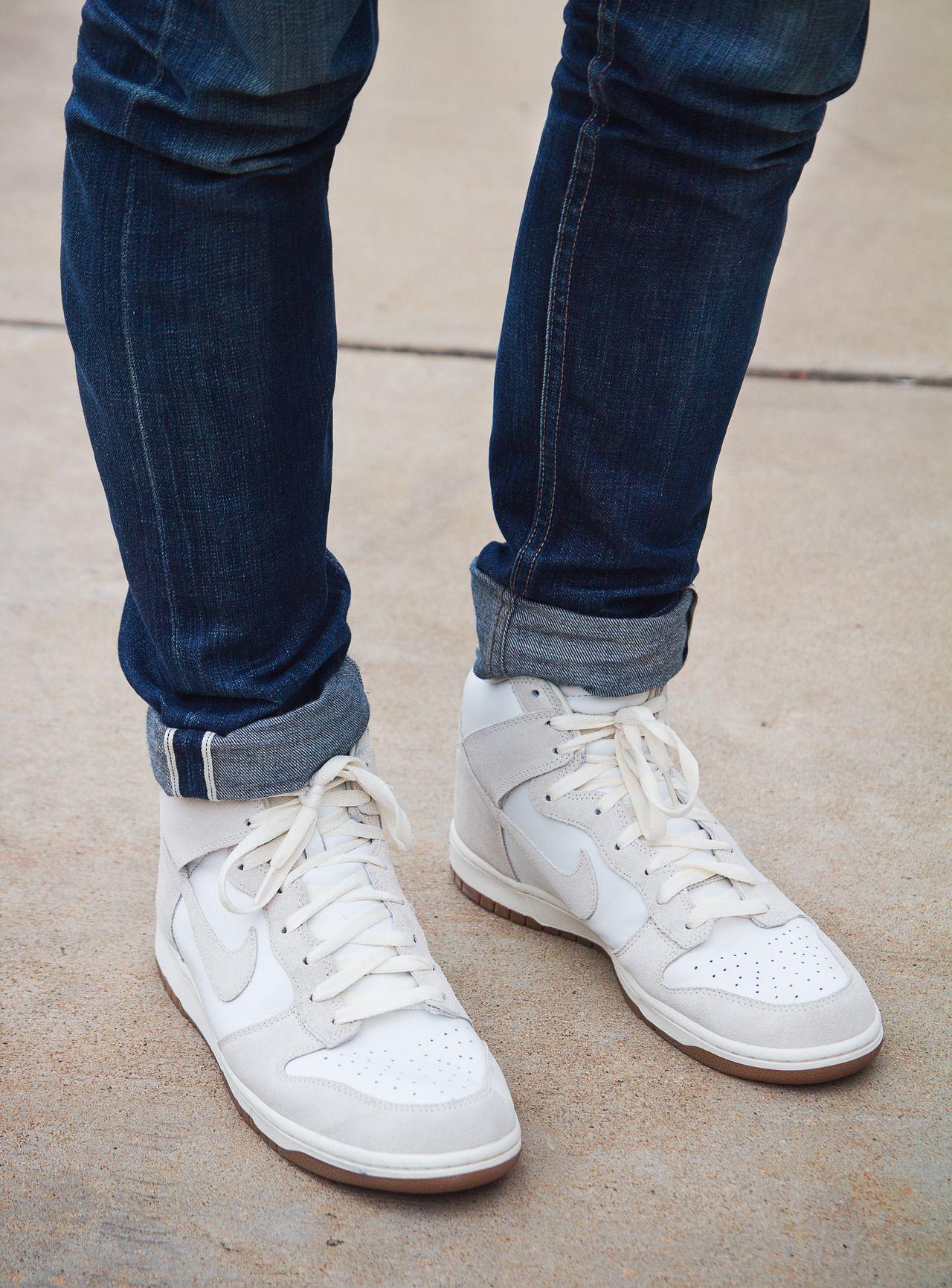 All white Nike Dunk Hi.