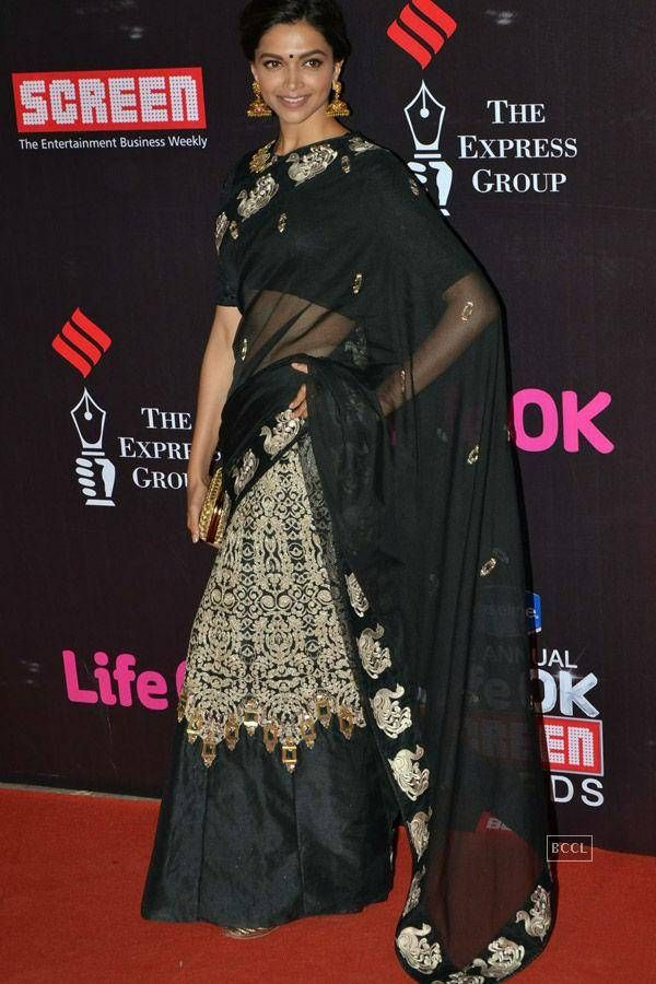 Deepika Padukone in a black and golden embroidered saree ...