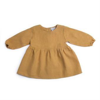 Enkel og fin kjole i nydelig farve som gjør esg veldig bra på bilder. + Lin = gull