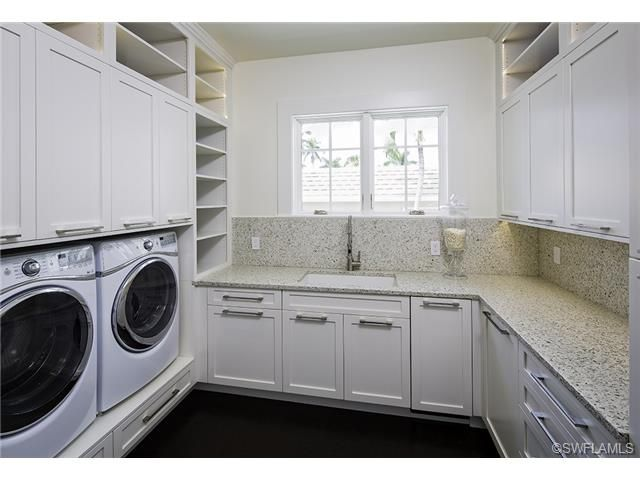 Large Luxurious Laundry Room With Custom Cabinets In Aqualane