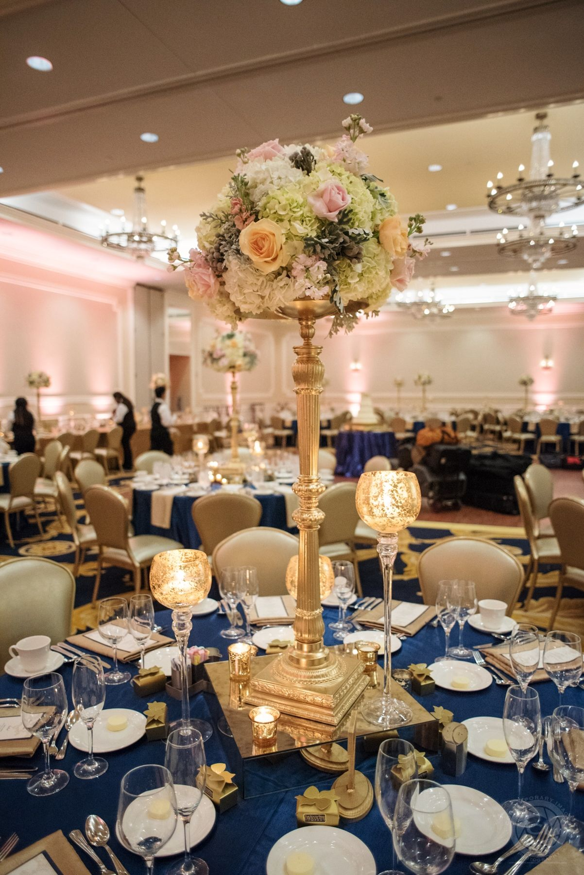 Polished navy blue gold and blush wedding reception