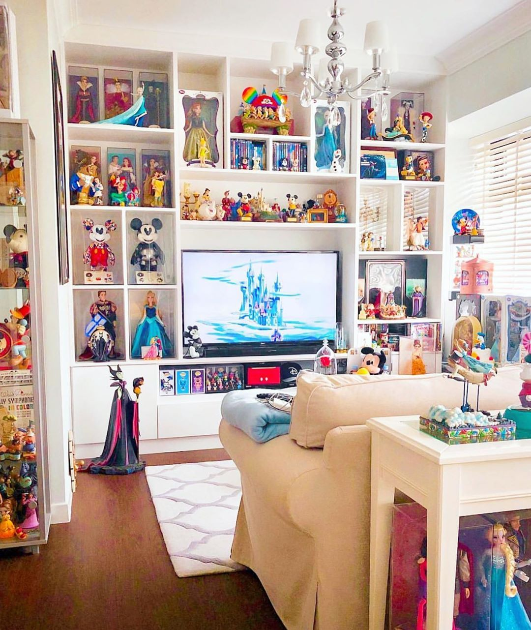 "Disney At Home on Instagram: ""Our friend @davdaf has such a magical living room! An amazing collection of Disney to surround you while you lounge with Disney movies,…"""