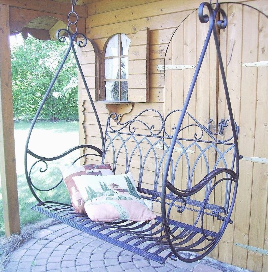The Straightforward Wooden Swing Is A Traditional Backyard