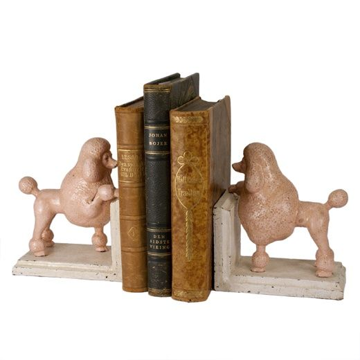 Stately pink poodles hold court on your bookshelf. Heavy cast iron bookends with a vintage finish in cream and pink.