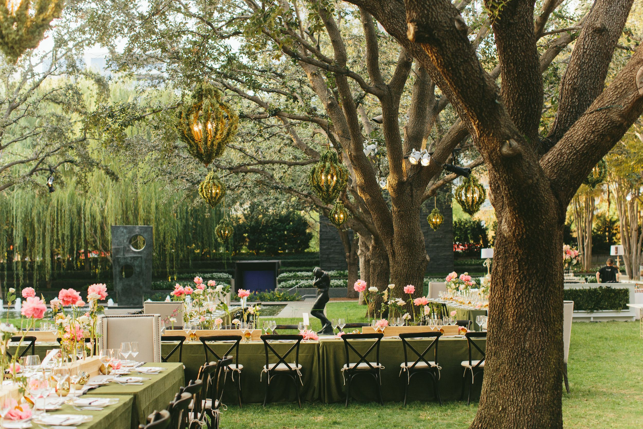 A Secret Garden Themed Outdoor Reception With Greenery Covered Lanterns In The Trees At The Nasher Sculpture In 2020 Fall Garden Wedding Outdoor Reception Reception