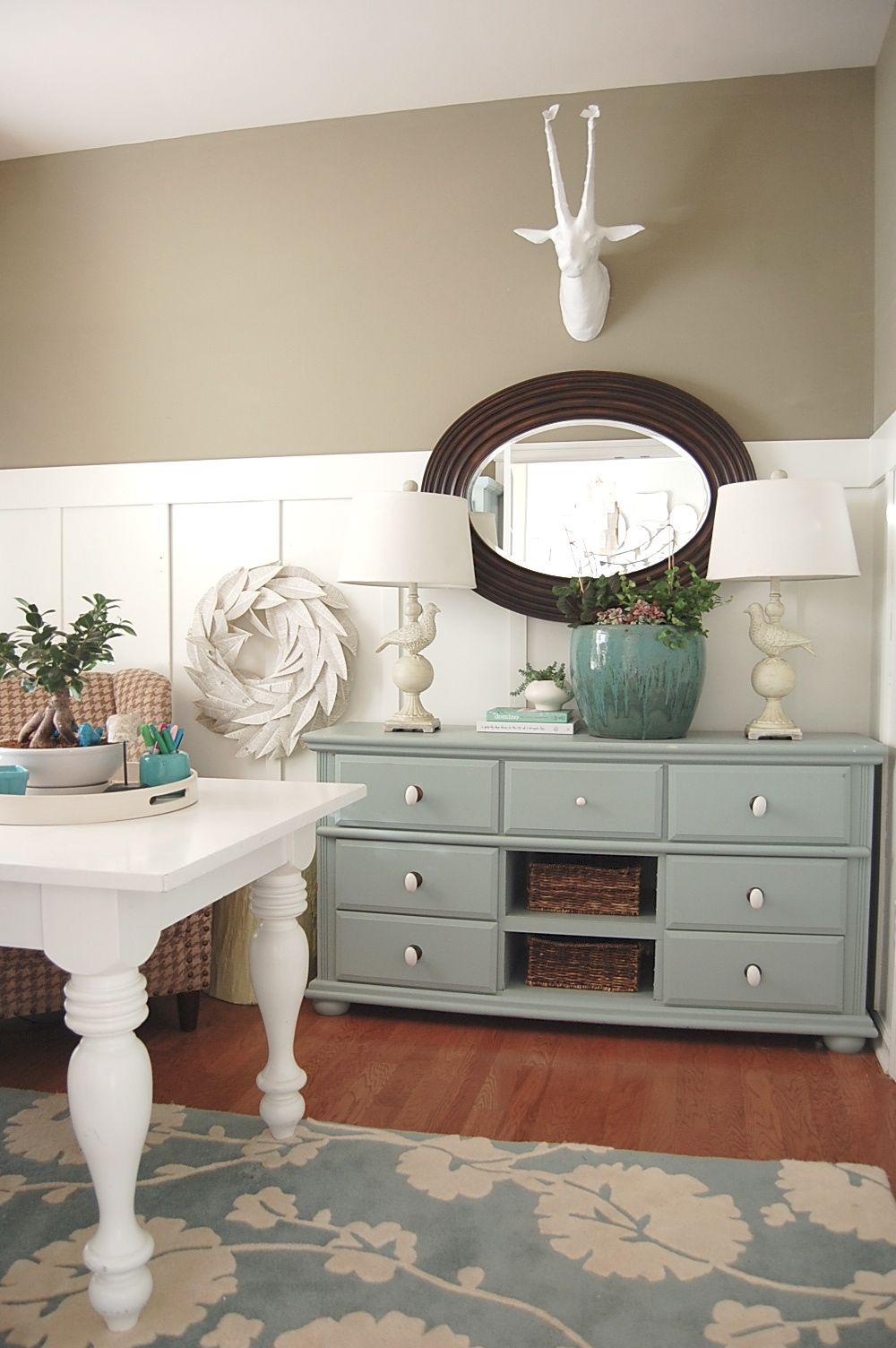 Tan walls sherwin williams rice grain with the blue gray whit and dark accents
