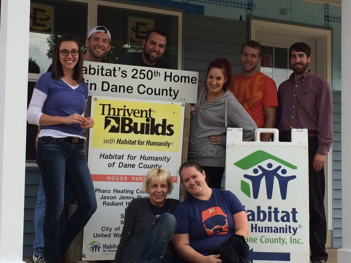 Habitat for Humanity staff lent a helping hand as they worked on the 250th Habitat Dane home built in Dane County.