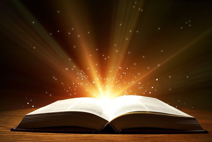 Light Book Old Open Book With Magic Light And Falling Stars On Wooden Table