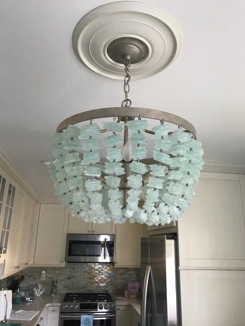 Here It Is With What Looks Like Possibly Glass Tile Backsplash