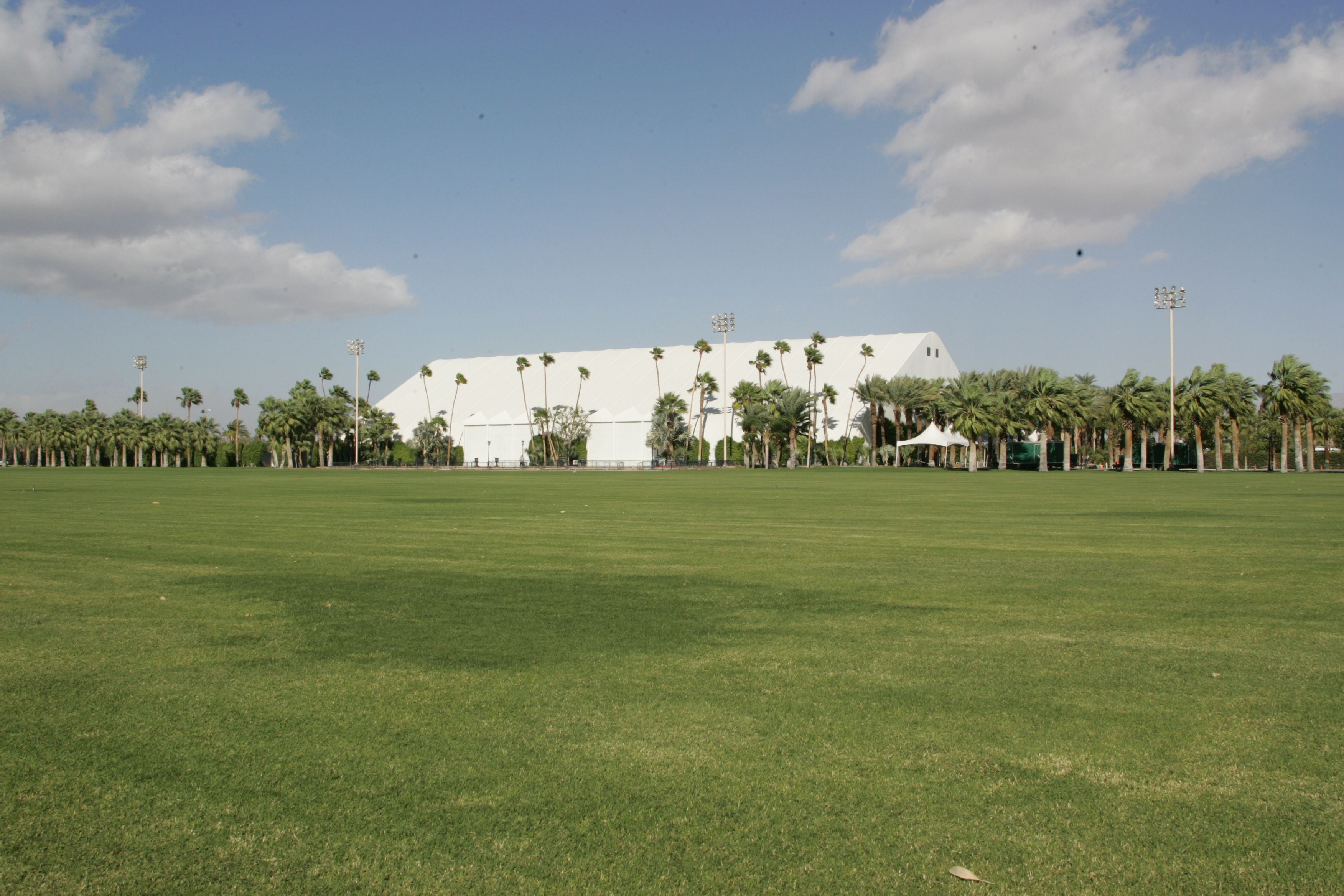 The Forum venue showing building in the distance and polo field in the foreground.