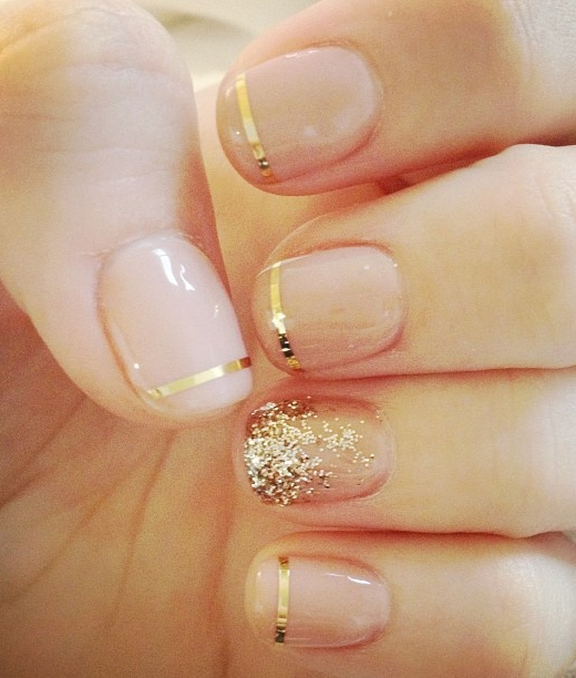 Nude nails with gold tips and an accent nail. Pretty for the season ...