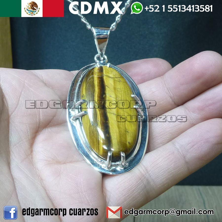 160726b1ee62 Tengo a la venta este hermoso cabujon de ojo de tigre con una montura muy  original