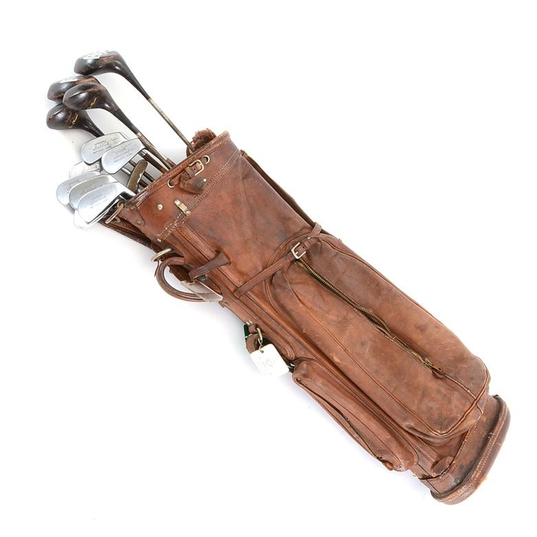 "A set of golf clubs used by Proctor and Gamble heir, Louis Nippert. Louis Nippert was part owner of the Cincinnati Reds and Bengals. There are eight wood shaft clubs, four irons and one putter (not a wood shaft). Each club, has Louis's name engraved onto the crown. The bag has three name tags; two of the tags have the ""Carmargo Club"" along with his name. The wood shaft clubs are Spalding; the woods are ""Jimmy Thomson"" Spalding. The putter is a Wilson ""Augusta"". There is no paperwork."