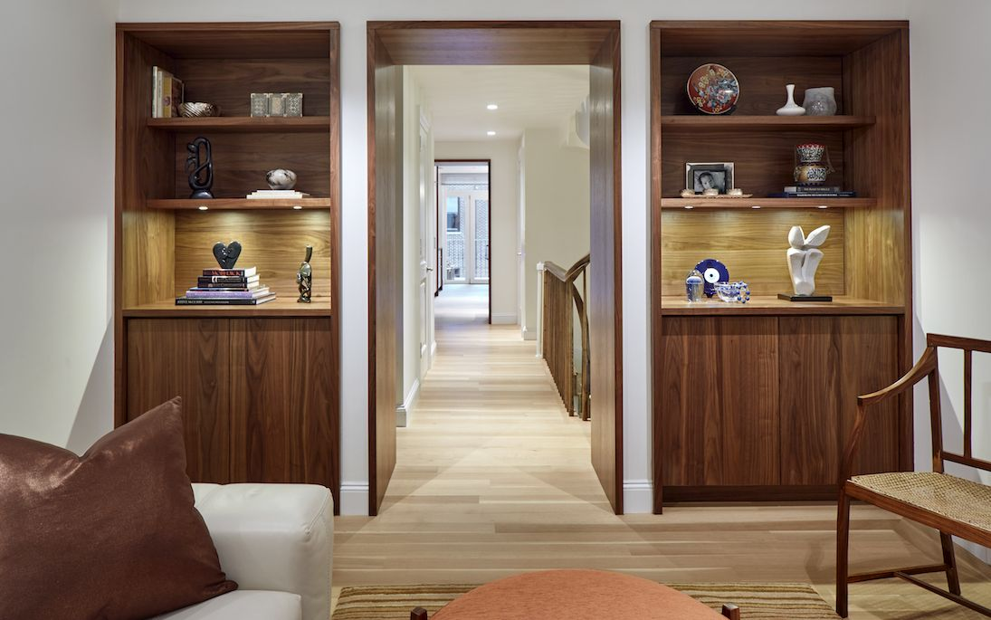 AFTER: A pair of walnut built-in bookcases flank the doorway. I Décor Aid I