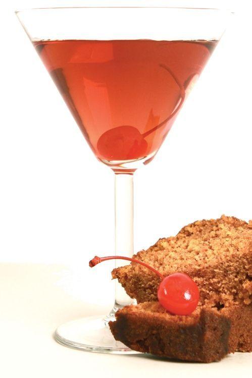 Fruitcake Martini - 1 ½ oz. Spiced 1 ½ oz. Bénédictine. ½ oz. Frangelico. ½ oz. Grand Marnier. 1 oz. Earl Grey Tea. A few drops of maraschino cherry liquid.