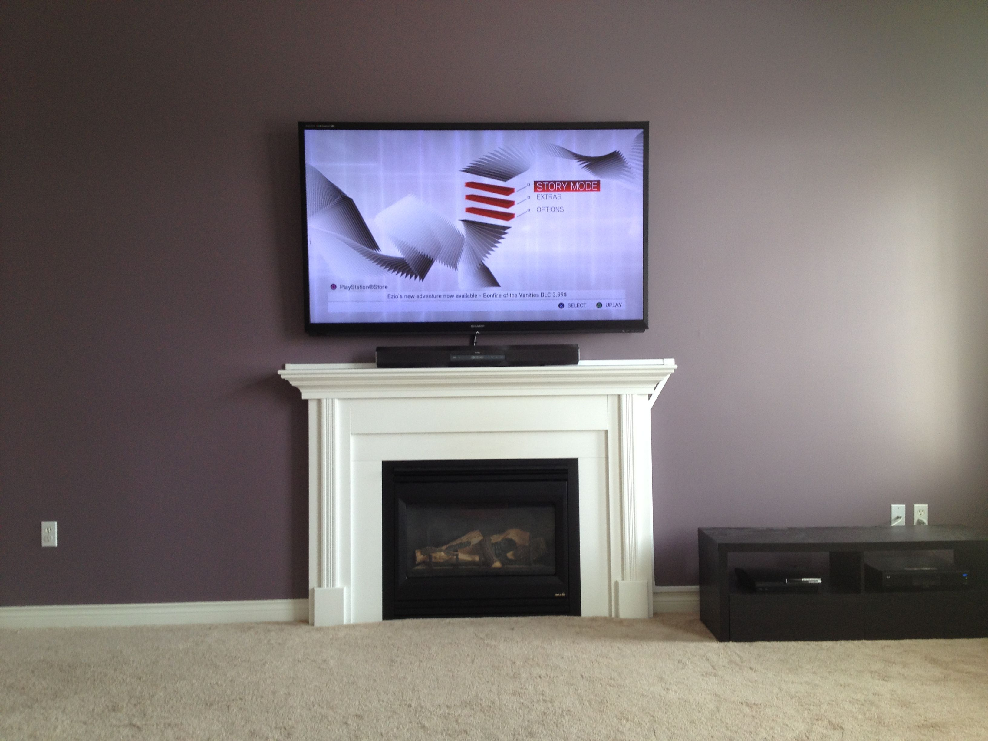 Tv Wall Mounted Over Fireplace With Wires Hidden With Raceway Tv Wall Mount Installation Tv Wall Wall Mounted Tv