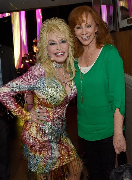 Reba McEntire Photos Photos - Reba McEntire visits Dolly Parton backstage during Dolly Parton: Pure & Simple Benefiting The Opry Trust Fund at Ryman Auditorium on August 1, 2015 in Nashville, Tennessee. - Dolly Parton: Pure and Simple, Benefiting the Opry Trust Fund