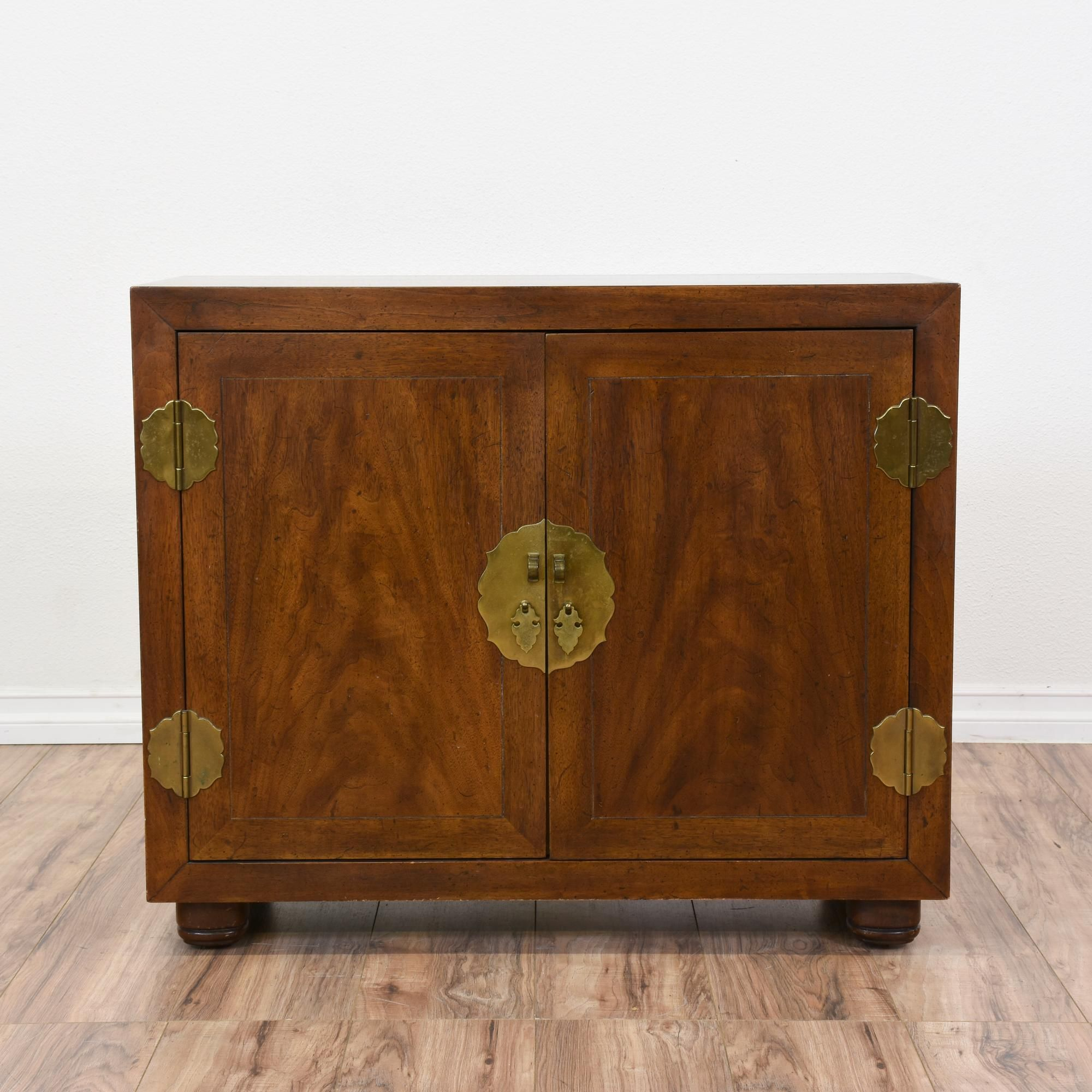 This Asian inspired buffet cabinet is featured in a solid wood ...