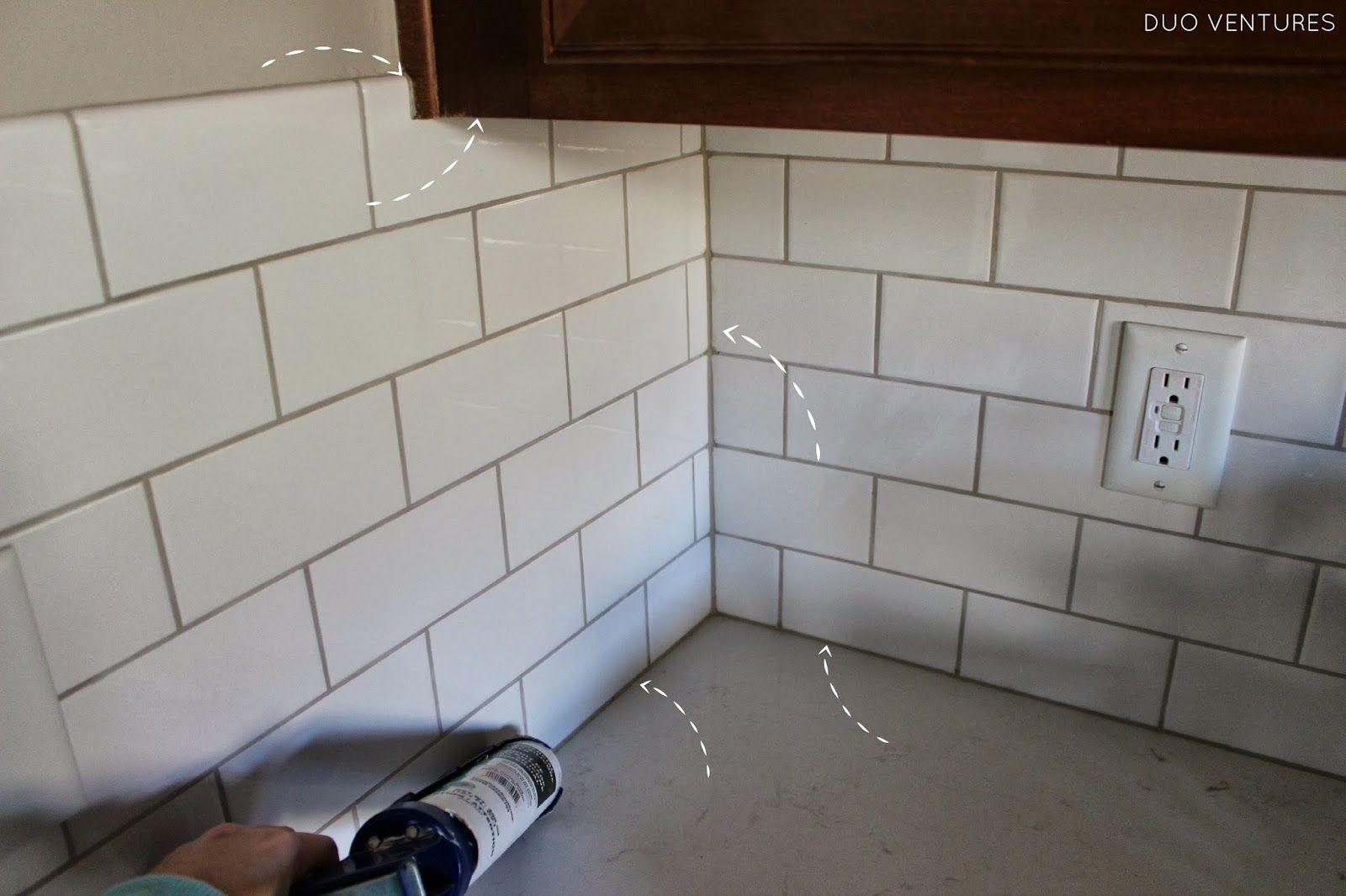 caulking subway tile backsplash