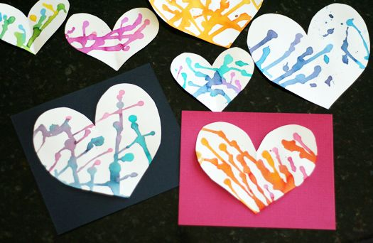 Drop watercolor on heart-shaped paper. Then tip the heart to create colorful tracks.